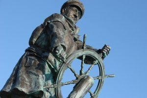 Statue of Captain at the Wheel of a ship Reframing Wellness